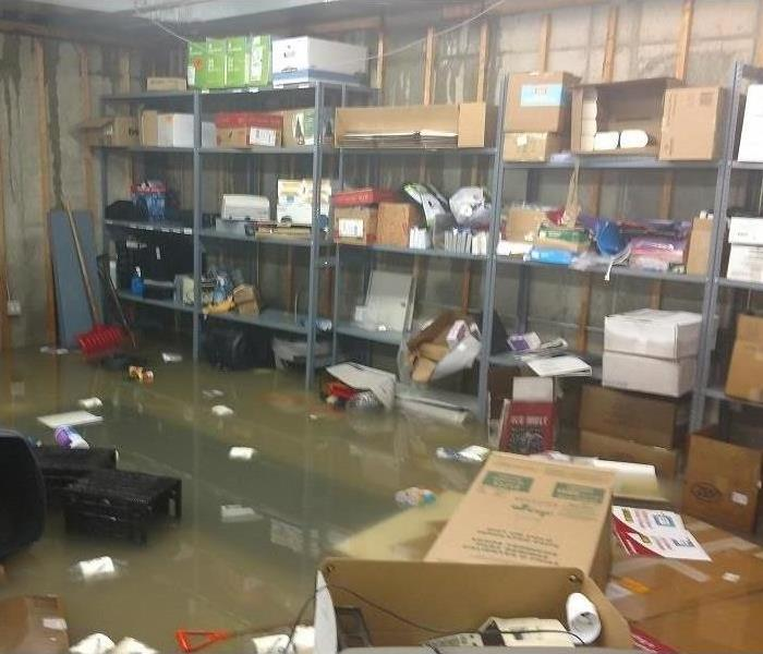 Flooded basement inside a bank Before