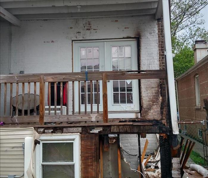 A backyard porch and deck that suffered fire damages.
