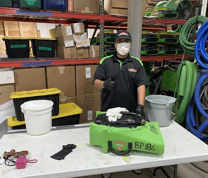 SERVPRO Bedford Park/Burbank technician disinfecting an air mover.