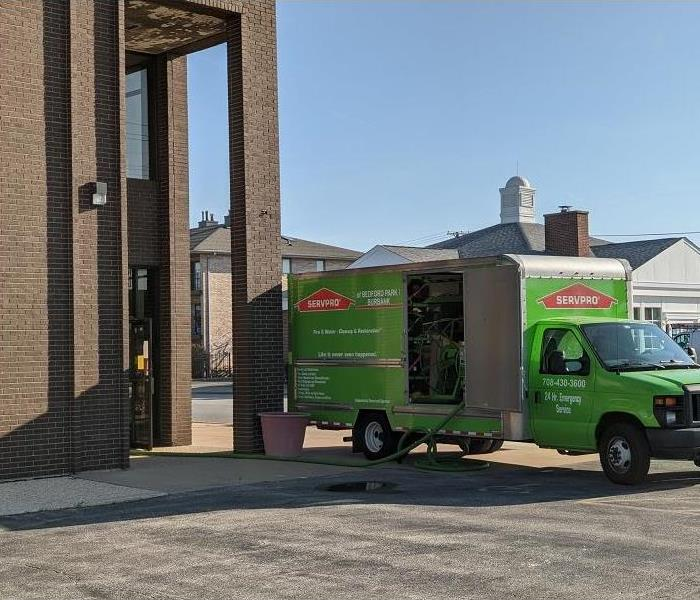 SERVPRO truck parked outside of a bank