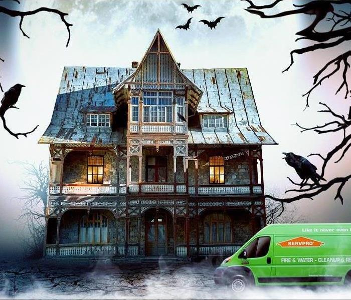 A SERVPRO truck parked in front of a scary house